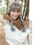 Купить «Woman in fur hat with woolen scarf and jacket in the woods», фото № 30023724, снято 20 августа 2013 г. (c) Wavebreak Media / Фотобанк Лори