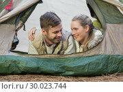 Купить «Smiling couple lying in tent after a hike», фото № 30023744, снято 20 августа 2013 г. (c) Wavebreak Media / Фотобанк Лори