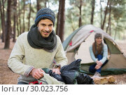 Купить «Young couple camping in the wilderness», фото № 30023756, снято 20 августа 2013 г. (c) Wavebreak Media / Фотобанк Лори
