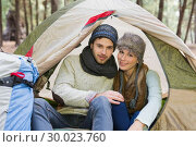 Купить «Smiling couple in tent with backpack in the wilderness», фото № 30023760, снято 20 августа 2013 г. (c) Wavebreak Media / Фотобанк Лори