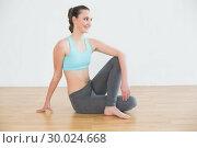 Купить «Fit woman in cowface posture in fitness studio», фото № 30024668, снято 23 июля 2013 г. (c) Wavebreak Media / Фотобанк Лори