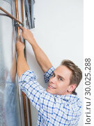 Купить «Technician servicing an hot water heater pipes», фото № 30025288, снято 25 июля 2013 г. (c) Wavebreak Media / Фотобанк Лори