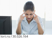 Купить «Tired businesswoman suffering from headache in front of computer», фото № 30026164, снято 30 июля 2013 г. (c) Wavebreak Media / Фотобанк Лори