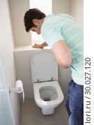 Купить «Man with stomach sickness about to vomit into the toilet», фото № 30027120, снято 2 августа 2013 г. (c) Wavebreak Media / Фотобанк Лори