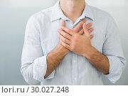Купить «Mid section of a man with chest pain», фото № 30027248, снято 2 августа 2013 г. (c) Wavebreak Media / Фотобанк Лори