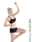 Купить «Beautiful sporty young woman cheering», фото № 30027404, снято 6 августа 2013 г. (c) Wavebreak Media / Фотобанк Лори