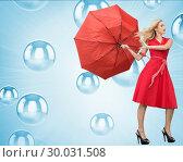 Купить «Composite image of elegant blonde holding umbrella», фото № 30031508, снято 1 ноября 2013 г. (c) Wavebreak Media / Фотобанк Лори