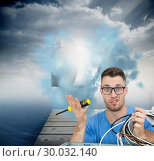 Купить «Composite image of portrait of confused it professional with screw driver and cables in front of ope», фото № 30032140, снято 2 ноября 2013 г. (c) Wavebreak Media / Фотобанк Лори