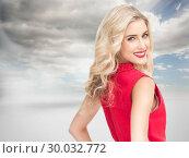 Купить «Composite image of smiling blonde standing hands on hips», фото № 30032772, снято 2 ноября 2013 г. (c) Wavebreak Media / Фотобанк Лори