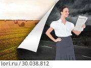 Composite image of cheerful stylish businesswoman holding newspaper. Стоковое фото, агентство Wavebreak Media / Фотобанк Лори