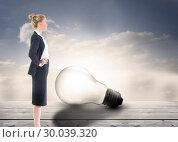 Купить «Composite image of businesswoman standing with hands on hips», фото № 30039320, снято 10 ноября 2013 г. (c) Wavebreak Media / Фотобанк Лори