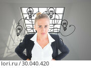 Купить «Composite image of businesswoman standing with hands on hips», фото № 30040420, снято 10 ноября 2013 г. (c) Wavebreak Media / Фотобанк Лори