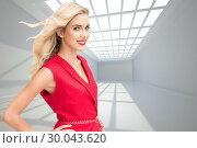 Купить «Composite image of smiling blonde standing hands on hips», фото № 30043620, снято 11 ноября 2013 г. (c) Wavebreak Media / Фотобанк Лори