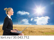 Composite image of businesswoman using laptop. Стоковое фото, агентство Wavebreak Media / Фотобанк Лори