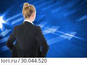 Купить «Composite image of businesswoman standing with hands on hips», фото № 30044520, снято 11 ноября 2013 г. (c) Wavebreak Media / Фотобанк Лори