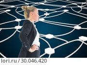 Купить «Composite image of businesswoman standing with hands on hips», фото № 30046420, снято 11 ноября 2013 г. (c) Wavebreak Media / Фотобанк Лори