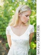 Купить «Content beautiful blonde bride», фото № 30047036, снято 9 октября 2013 г. (c) Wavebreak Media / Фотобанк Лори