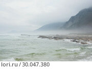 Купить «Ocean against the misty mountains», фото № 30047380, снято 10 октября 2013 г. (c) Wavebreak Media / Фотобанк Лори