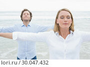 Купить «Peaceful couple with eyes closed at beach», фото № 30047432, снято 10 октября 2013 г. (c) Wavebreak Media / Фотобанк Лори