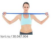 Купить «Serious fit young woman holding blue yoga belt», фото № 30047904, снято 15 октября 2013 г. (c) Wavebreak Media / Фотобанк Лори
