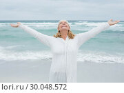 Купить «Senior woman with arms outstretched at beach», фото № 30048572, снято 11 октября 2013 г. (c) Wavebreak Media / Фотобанк Лори