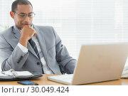 Купить «Smiling businessman looking at laptop in office», фото № 30049424, снято 3 ноября 2013 г. (c) Wavebreak Media / Фотобанк Лори