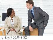 Купить «Colleagues conversing in office», фото № 30049524, снято 3 ноября 2013 г. (c) Wavebreak Media / Фотобанк Лори