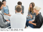 Купить «Group therapy in session sitting in a circle», фото № 30050116, снято 4 ноября 2013 г. (c) Wavebreak Media / Фотобанк Лори