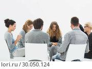 Купить «Group therapy in session sitting in a circle», фото № 30050124, снято 4 ноября 2013 г. (c) Wavebreak Media / Фотобанк Лори