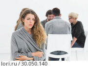 Купить «Therapy in session sitting in a circle while woman in foreground», фото № 30050140, снято 4 ноября 2013 г. (c) Wavebreak Media / Фотобанк Лори