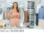 Купить «Female fashion designer with laptop and cellphone», фото № 30050864, снято 5 ноября 2013 г. (c) Wavebreak Media / Фотобанк Лори