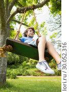 Купить «Low angle view of a cute little boy on swing», фото № 30052316, снято 8 ноября 2013 г. (c) Wavebreak Media / Фотобанк Лори