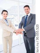 Купить «Cheerful business colleagues joining hands together», фото № 30055520, снято 2 ноября 2013 г. (c) Wavebreak Media / Фотобанк Лори