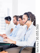 Купить «Business colleagues with headsets in a row», фото № 30055560, снято 2 ноября 2013 г. (c) Wavebreak Media / Фотобанк Лори