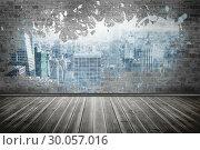 Splash on wall revealing city. Стоковое фото, агентство Wavebreak Media / Фотобанк Лори