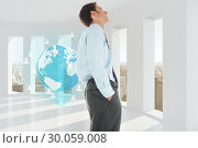 Купить «Composite image of happy businessman standing with hand in pocket», фото № 30059008, снято 11 декабря 2013 г. (c) Wavebreak Media / Фотобанк Лори