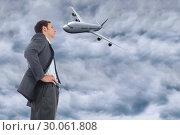 Купить «Composite image of stern businessman standing with hands on hips», фото № 30061808, снято 11 января 2014 г. (c) Wavebreak Media / Фотобанк Лори