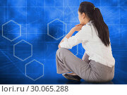 Купить «Composite image of businesswoman sitting cross legged», фото № 30065288, снято 11 января 2014 г. (c) Wavebreak Media / Фотобанк Лори