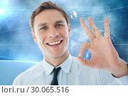 Composite image of businessman showing ok sign. Стоковое фото, агентство Wavebreak Media / Фотобанк Лори