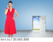 Купить «Composite image of cheerful elegant brunette in red dress on the phone posing», фото № 30065888, снято 11 января 2014 г. (c) Wavebreak Media / Фотобанк Лори