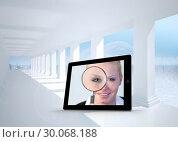 Купить «Composite image of businesswoman holding magnfying glass on tablet screen», фото № 30068188, снято 29 января 2014 г. (c) Wavebreak Media / Фотобанк Лори