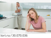 Купить «Couple not talking after an argument in kitchen», фото № 30070036, снято 18 октября 2013 г. (c) Wavebreak Media / Фотобанк Лори