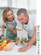 Купить «Couple preparing food together in kitchen», фото № 30070116, снято 18 октября 2013 г. (c) Wavebreak Media / Фотобанк Лори