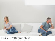Купить «Unhappy couple not talking after an argument at home», фото № 30070348, снято 18 октября 2013 г. (c) Wavebreak Media / Фотобанк Лори