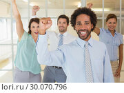 Купить «Cheerful business colleagues cheering in office», фото № 30070796, снято 19 декабря 2013 г. (c) Wavebreak Media / Фотобанк Лори