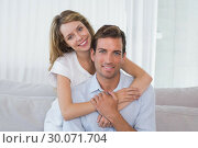 Купить «Loving young woman embracing man at home», фото № 30071704, снято 17 декабря 2013 г. (c) Wavebreak Media / Фотобанк Лори
