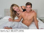 Купить «Romantic young couple in underwear in bed», фото № 30071816, снято 17 декабря 2013 г. (c) Wavebreak Media / Фотобанк Лори