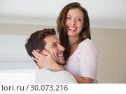 Купить «Close-up side view of a loving young couple», фото № 30073216, снято 12 декабря 2013 г. (c) Wavebreak Media / Фотобанк Лори