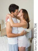 Купить «Loving young couple about to kiss at home», фото № 30073704, снято 12 декабря 2013 г. (c) Wavebreak Media / Фотобанк Лори