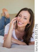 Купить «Smiling woman using mobile phone in bed», фото № 30073776, снято 12 декабря 2013 г. (c) Wavebreak Media / Фотобанк Лори